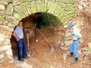 digging out the lime kilns funnel at the bottom of the chimney