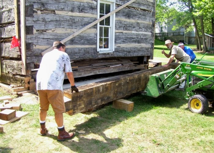 our volunteers help with replacing sill logs