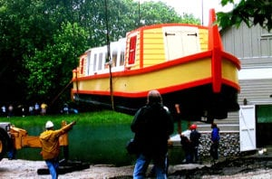 lowering the delphi canal boat into the water