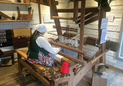 see weavers at work in the loom house in delphi indiana